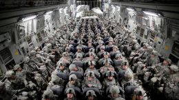 US soldiers aboard a plane bound for Afghanistan (2010)